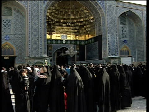 1st may 2000 ws women in black veils standing in courtyard of saint massoumeh shrine / qum, iran - pellegrino video stock e b–roll