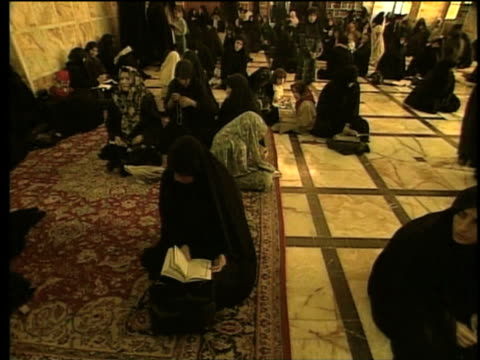stockvideo's en b-roll-footage met 1st may 2000 ws women sitting on floor inside saint massoumeh shrine / qum, iran - op de grond zitten