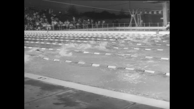 vídeos y material grabado en eventos de stock de 200meter men's freestyle race / don schollander wins and sets world record in lincoln nebraska - oficial deportivo