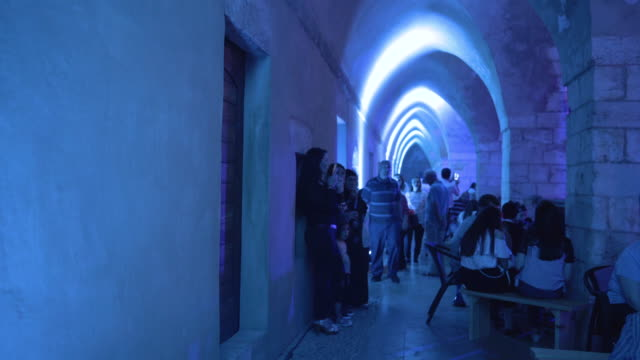 khan al-askar. fast motion of people moving through a vaulted corridor in the medieval khan al-askar building, during a post-iftar musical... - fast motion stock videos & royalty-free footage