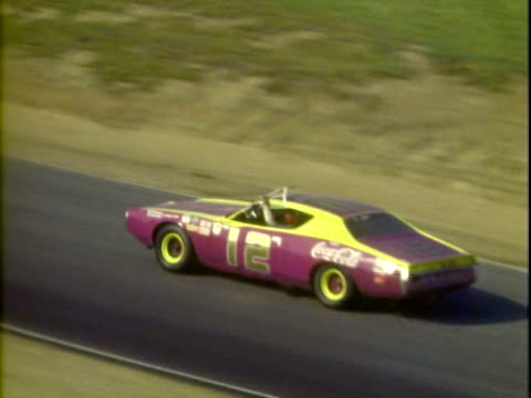 20Jun1971 WS HA PAN Charlie Roberts in '70 Ford on side of racetrack following accident at Winston Golden State 400 then walking away from car at...