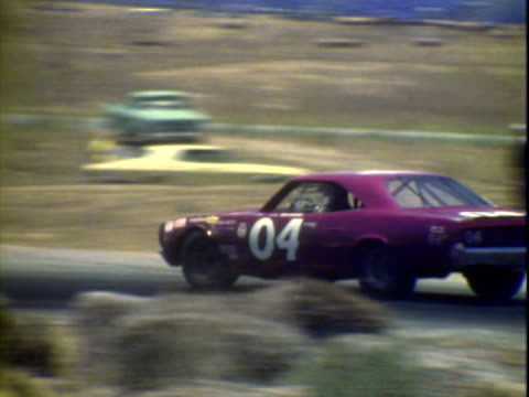 jun-1971 montage bobby allison driving '70 dodge, richard petty driving '71 plymouth, both taking corner while competing in winston golden state 400... - personal land vehicle stock videos & royalty-free footage