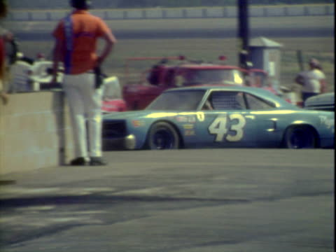 vídeos de stock e filmes b-roll de 20jun1971 montage hershel mcgriff driving '70 plymouth gtx into pits then pulling back into race competing in winston golden state 400 stock car race... - menos de 10 segundos