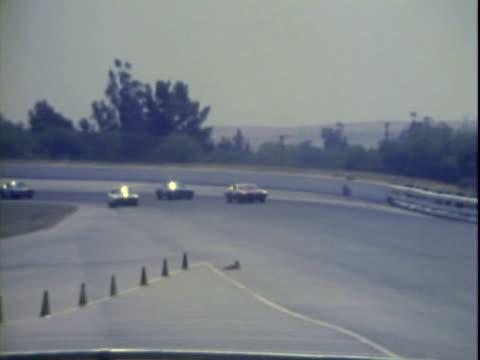 20Jun1971 MONTAGE Pit crew working on Ray Elder's '71 Dodge Challenger at Riverside International Raceway during Winston Golden State 400 stock car...