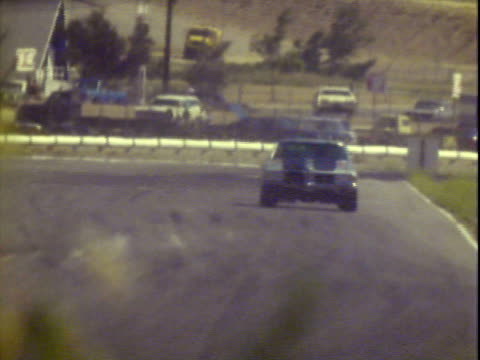 20jun1971 ws winston cup welcome race fans banner at riverside international raceway / pan bobby allison driving '70 dodge past line stand / pan... - personal land vehicle stock videos & royalty-free footage