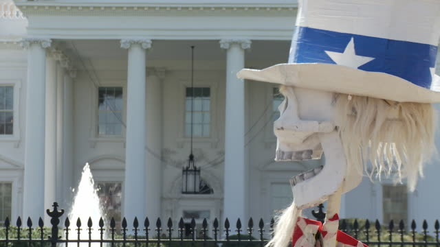 20mar2010 cu large paper skull dressed like uncle sam in front of white house / washington dc usa / audio - evil stock videos and b-roll footage