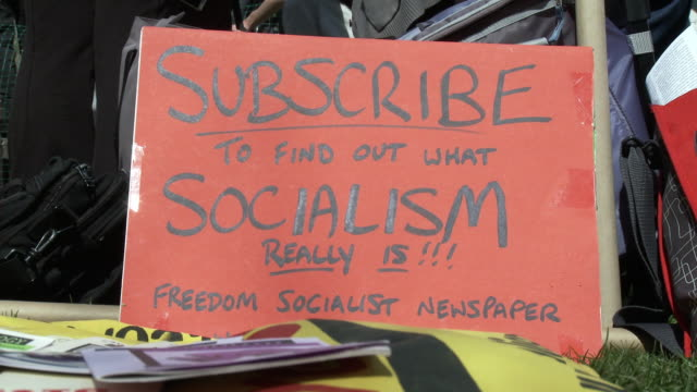 mar-2010 sign that says subscribe to find out what socialism really is. freedom socialist newspaper / washington dc, usa / audio - socialism stock videos & royalty-free footage