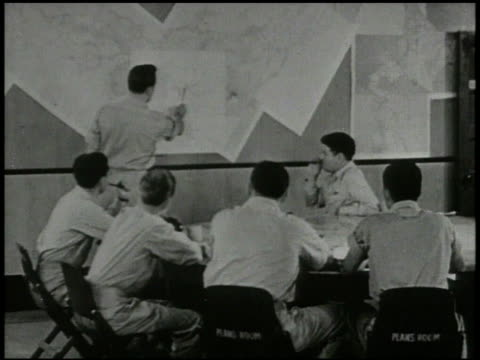 vs 20th air force headquarters int vs us army air corps general curtis lemay amp staff in planning room looking over maps cu hand selecting target... - 1945点の映像素材/bロール