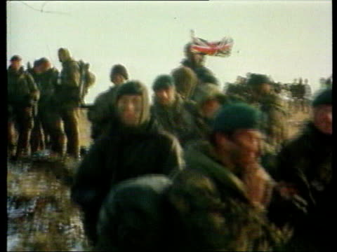 20th anniversary prince andrew lib british soldiers union flag flying from pack of royal marines as they yomp away pull out - ヨーク公 アンドルー王子点の映像素材/bロール