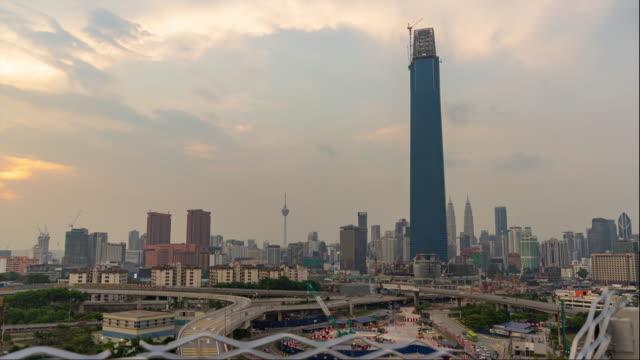 KUALA LUMPUR, MALAYSIA - 20th AUG 2018; 4K Time lapse of cloudy sunset over downtown Kuala Lumpur, Malaysia.