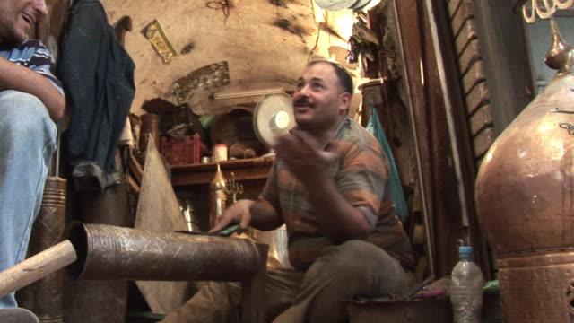 vídeos de stock e filmes b-roll de 20th jul 2009 ms craftsman working in shop al mutanabee street / baghdad iraq - só um homem de idade mediana