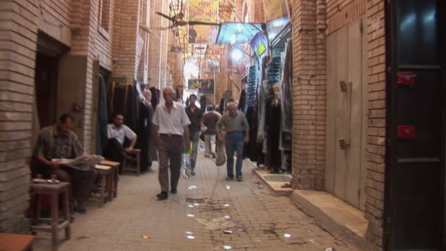 20th jul 2009 customers and vendors in al mutanabee street / baghdad, iraq - alley stock videos & royalty-free footage