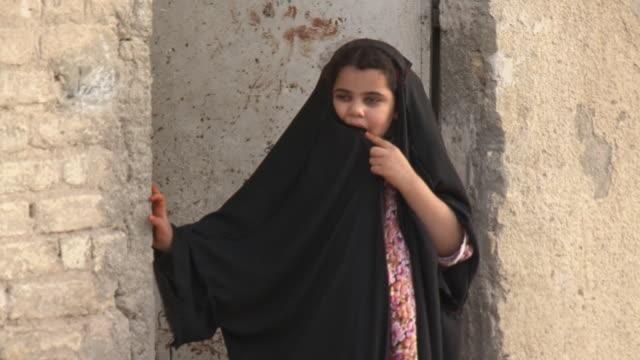 20th jul 2009 ms girl wearing burka standing in doorway in shanasheel district / basra iraq - burka stock videos and b-roll footage