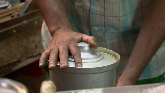 20th jul 2009 ms zi zo cu man preparing food in souk al safaseer market / baghdad iraq - one mid adult man only stock videos & royalty-free footage