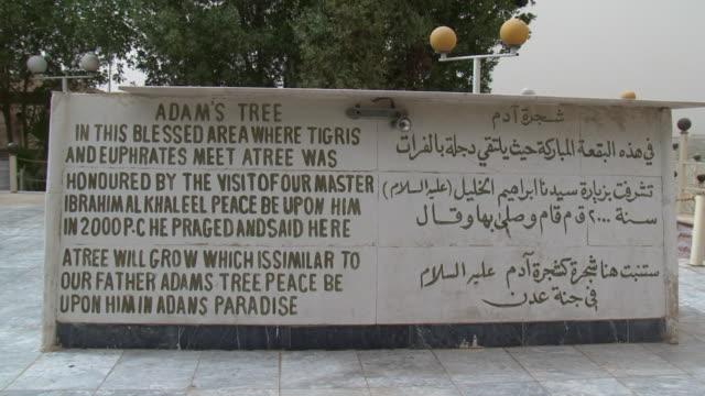 vídeos y material grabado en eventos de stock de 20th jul 2009 memorial plaque near ceremonial tree dedicated to adam and eve / baghdad, iraq - escritura occidental