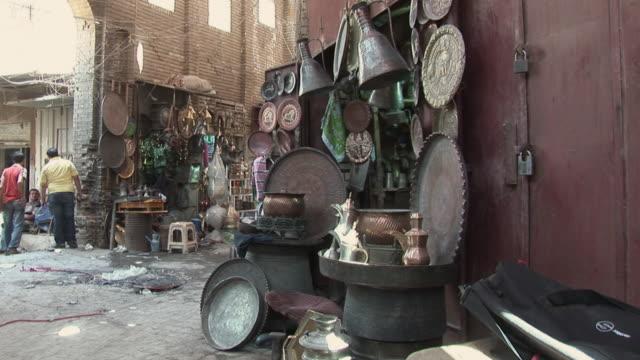 20th jul 2009 montage market stall with antique utensils / baghdad iraq - 雑貨点の映像素材/bロール