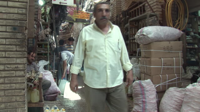 20th jul 2009 montage people shopping in al mutanabee street / baghdad iraq - only mid adult men stock videos & royalty-free footage