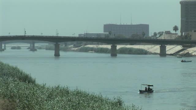 stockvideo's en b-roll-footage met 20th jul 2009 montage tigris river with bridge / baghdad iraq - bagdad