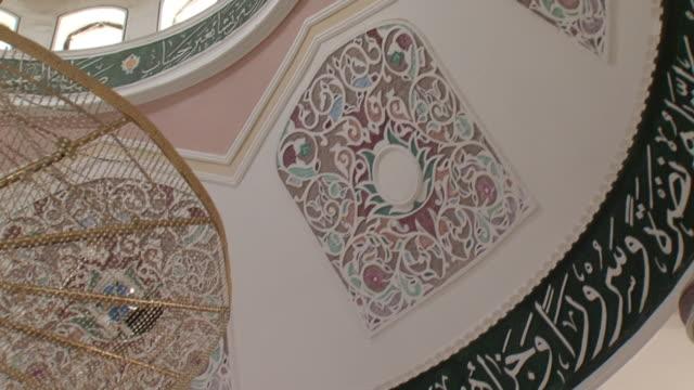 20th jul 2009 cu la pan ornate chandelier and murals inside al mustasrwyra historic school built in 1233 / baghdad iraq - madressa stock videos and b-roll footage