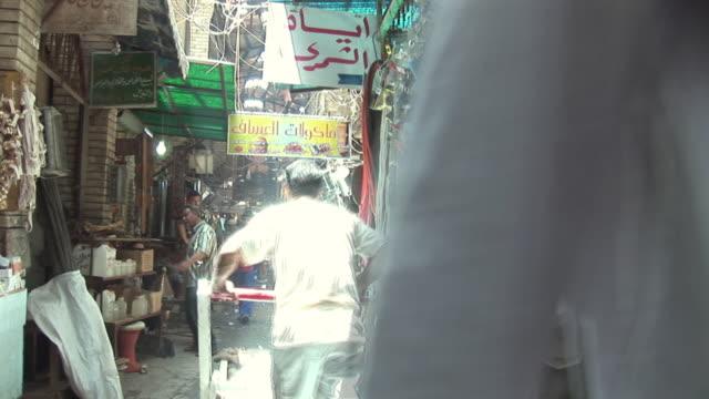 20th jul 2009 ws people shopping in al mutanabee street / baghdad iraq - butiksskylt bildbanksvideor och videomaterial från bakom kulisserna
