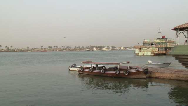 20th jul 2009 shat al arab area, moored boat / basra, iraq - basra video stock e b–roll