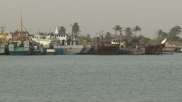 20th jul 2009 shat al arab area, moored trawlers / basra, iraq - basra video stock e b–roll