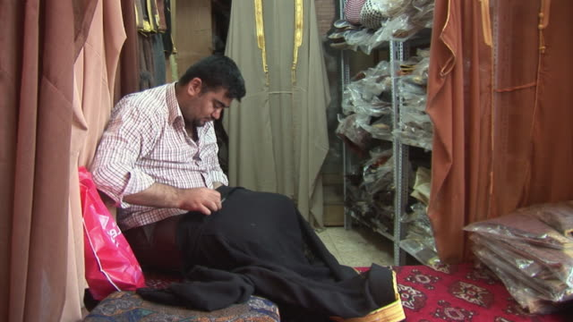 20th jul 2009 ws tailor sewing in workshop / baghdad iraq - one mid adult man only stock videos & royalty-free footage