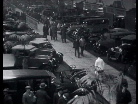 21jan1928 b/w montage cars being exhibited at the rai in amsterdam / amsterdam noordholland netherlands - 1928 stock videos & royalty-free footage