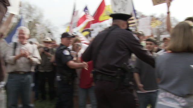 mar-2010 crowd chants no at health care reform supporters while police keep both groups apart / washington dc, usa / audio - 2010 stock videos & royalty-free footage