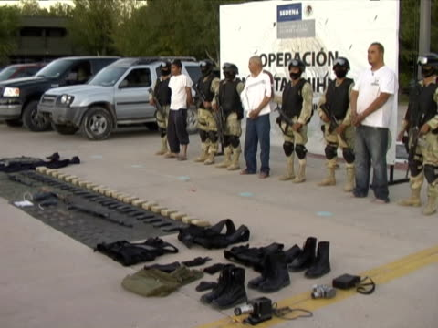 21mar2010 montage presentations by mexican military antinarcotics operations of alleged drug cartel members with their drug weapons caches including... - recreational drug stock videos & royalty-free footage