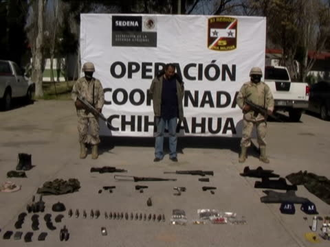 21Mar2010 MONTAGE Presentations by Mexican military antinarcotics operations of alleged drug cartel members with their drug weapons caches including...