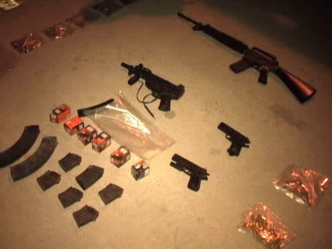 21mar2010 montage presentations by mexican military antinarcotics operations of alleged drug cartel members with their drug weapons caches including... - western script stock videos & royalty-free footage
