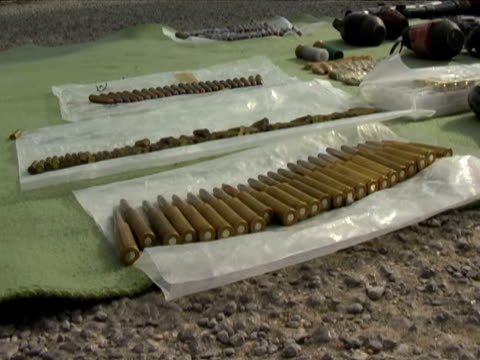 21mar2010 montage presentations by mexican military antinarcotics operations of intercepted weapons / ciudad juarez chihuahua mexico / audio - conquering adversity stock videos and b-roll footage