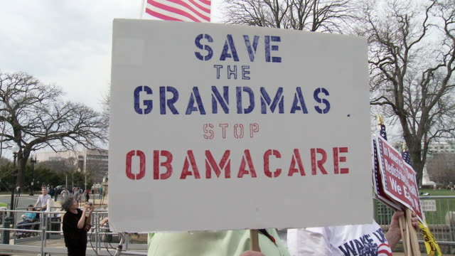 vídeos de stock, filmes e b-roll de 21mar2010 ms protestors holding sign saying save the grandmas stop obamacare / washington dc usa / audio - 2010