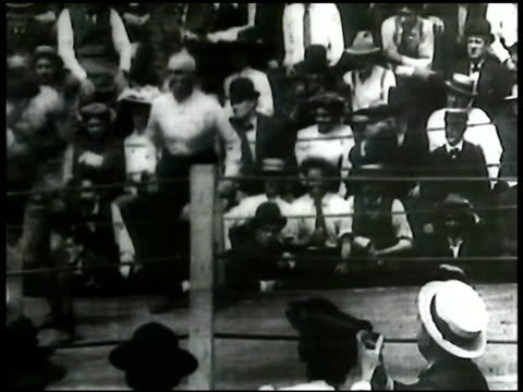 21st round africanamerican joe gans vs battling nelson battling nelson punching low bringing joe gans to knees referee holding arm up thomas edison... - 1906 stock videos and b-roll footage