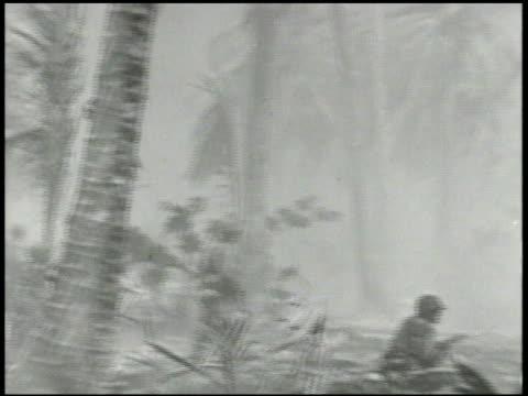 VS 22nd Marine Division advancing inland on Enjebi islet smoke in BG soldiers firing rifle soldiers amp M4 Sherman tanks advancing World War II WWII...