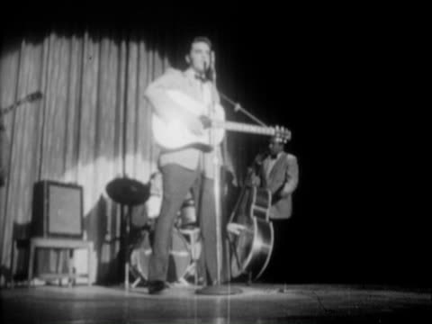 vidéos et rushes de 23apr1956 b/w montage lighted marquee outside the new frontier hotel casino in las vegas nevada night sammy lewis presents freddy martin band with... - 1956