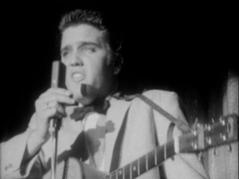 stockvideo's en b-roll-footage met 23apr1956 b/w montage lighted marquee outside the new frontier hotel casino in las vegas nevada night sammy lewis presents freddy martin band with... - 1956