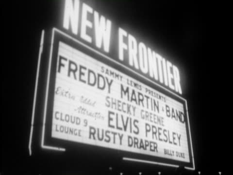 apr-1956 b/w montage lighted marquee outside the new frontier hotel + casino / sammy lewis presents freddy martin band with shecky greene. extra... - theatre banner commercial sign stock videos & royalty-free footage