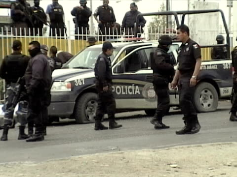 23apr2010 montage seven police officers one civilian were killed by heavily armed gunmen in apparent retaliation for the arrest of eight people tied... - killing people stock videos & royalty-free footage