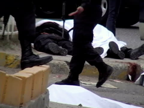 23apr2010 montage seven police officers one civilian were killed by heavily armed gunmen in apparent retaliation for the arrest of eight people tied... - wrapped stock videos & royalty-free footage