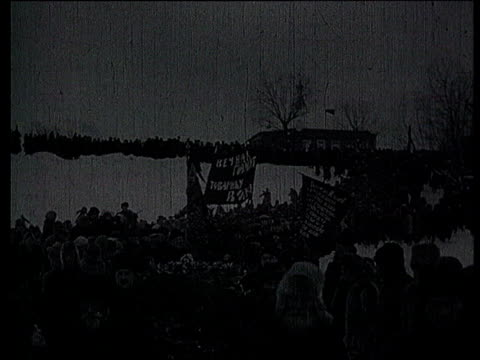 23jan1924 b/w montage lenin's funeral in gorki leninskiye lenin's body carried in procession crowd following coffin coffin load on train / gorki... - funeral procession stock videos & royalty-free footage
