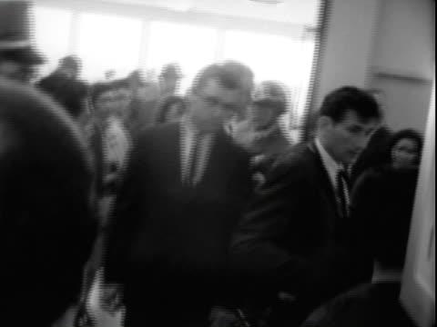 jun-1965 b/w montage reporters, newsreel cameramen standing at railing by corridor ramp at san francisco international airport / stream of united... - san francisco international airport stock videos & royalty-free footage