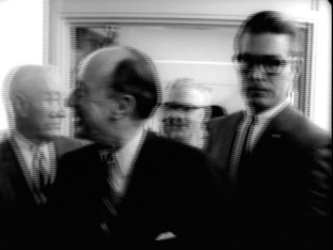 24jun1965 b/w montage united states ambassador to the united nations adlai stevenson walking along corridor with aides at san francisco international... - adlai stevenson ii stock videos and b-roll footage