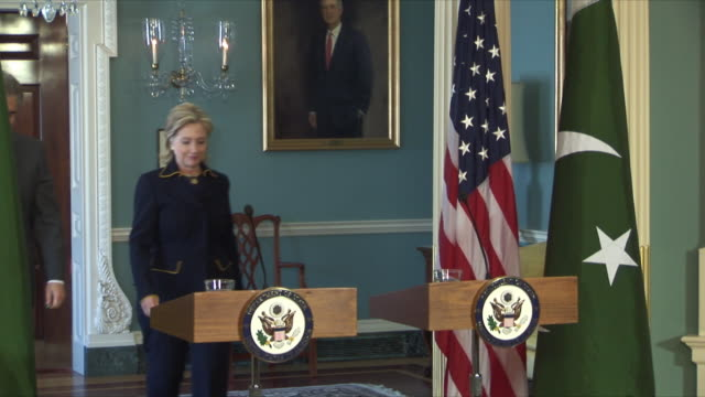 mar-2010 us secretary of state hillary clinton hosts pakistan foreign minister makhdoom shah mahmood qureshi for first full bilateral strategic talks... - lectern stock videos & royalty-free footage
