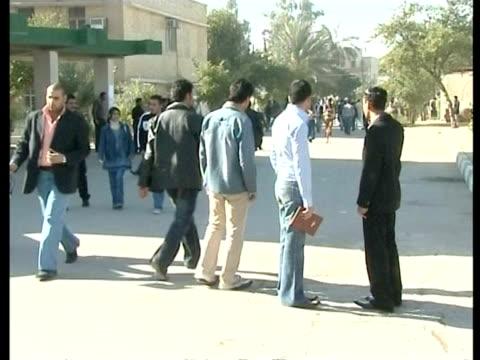 vídeos y material grabado en eventos de stock de 24th feb 2009 montage university students walking at baghdad university campus / baghdad, iraq - traje completo