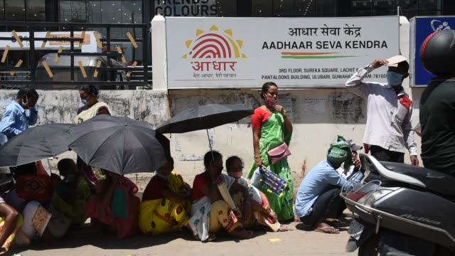 25th 2020: people flout social distancing norms as they stand in a queue to register for aadhar cards, amid the ongoing covid-19 coronavirus... - politics abstract stock videos & royalty-free footage