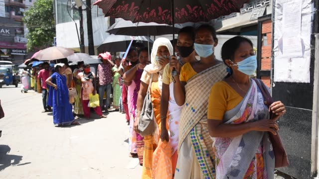 25th 2020: people flout social distancing norms as they stand in a queue to register for aadhar cards, amid the ongoing covid-19 coronavirus... - employment issues stock videos & royalty-free footage