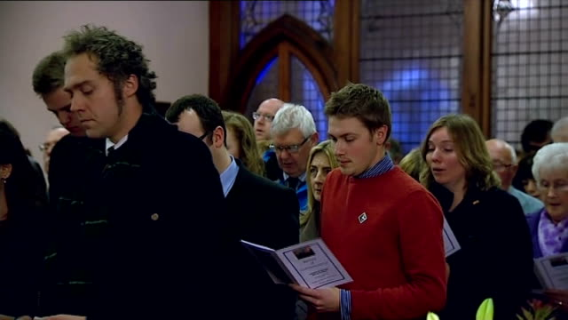 25th anniversary of lockerbie bombing marked scotland dumfries and galloway lockerbie int various shots of people singing hymm in church sot - dumfries and galloway stock videos & royalty-free footage