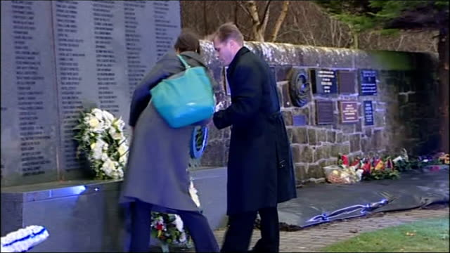 25th anniversary of lockerbie bombing marked scotland dumfries and galloway lockerbie ext man and woman laying wreath at memorial alex salmond msp... - dumfries and galloway stock videos & royalty-free footage